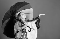 Waterproof accessories for children. Enjoy rainy weather with proper garments. Waterproof accessories make rainy day. Cheerful and pleasant. Kid girl happy hold royalty free stock image