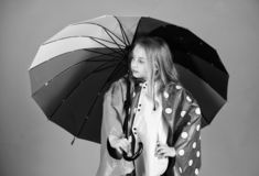 Waterproof accessories for children. Waterproof accessories make rainy day cheerful and pleasant. Kid girl happy hold. Colorful umbrella wear waterproof cloak stock photos