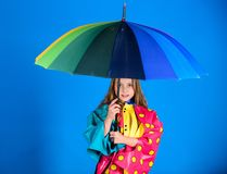 Waterproof accessories manufacture. Enjoy rainy weather with proper garments. Waterproof accessories make rainy day. Cheerful and pleasant. Kid girl happy hold royalty free stock photos
