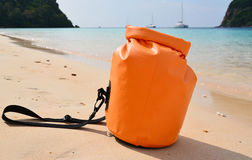 Waterproof bag. On the beach stock images