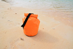 Waterproof bag. On the beach stock image