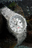 Waterproof chronograph watch. Waterproof sports chronograph watch under wather bubbles on it, macro Royalty Free Stock Photo