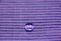Waterproof cloth. Drop on a purple waterproof cloth Stock Image
