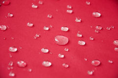 Waterproof coating textile, background with water drops. Stock Image