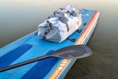 Waterproof duffel on stand up paddleboard Royalty Free Stock Image