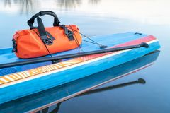 Waterproof duffel on stand up paddleboard Stock Photography