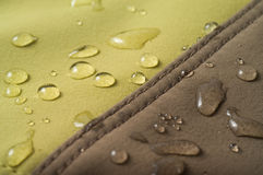 The waterproof fabric. Water drops on the cloth royalty free stock image