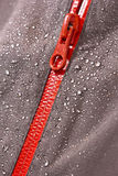 Waterproof material and zipper. Waterproof textile material and zipper with water drops on stock photo
