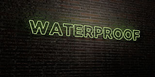 WATERPROOF -Realistic Neon Sign on Brick Wall background - 3D rendered royalty free stock image Royalty Free Stock Photo
