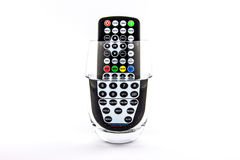 Waterproof TV remote control in a glass of water Stock Photo