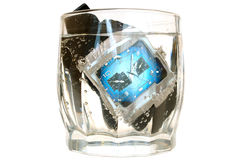 Waterproof watch in glass with water. Stock Images
