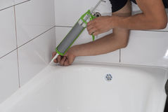 Waterproofing bath silicone sealant Royalty Free Stock Images