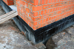Waterproofing foundation bitumen. Foundation Waterproofing, Damp proofing Coatings. Construction techniques for waterproofing base. Ment and foundations. Brick Stock Images