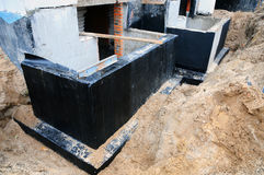 Waterproofing foundation bitumen. Foundation Waterproofing, Damp proofing Coatings. Waterproofing house foundation with spray on t. Ar. Construction techniques Stock Photo