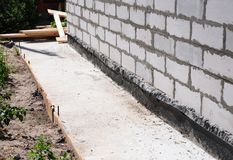 Waterproofing and insulation house  foundation wall. Foundation Waterproofing and Damp proofing Coatings. Waterproofing house foundation with bitumen membrane Stock Photography