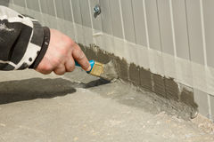 Waterproofing an outside wall-floor connection with ms polymer sealant Stock Photography