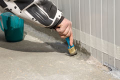 Waterproofing an outside wall-floor connection with ms polymer sealant Royalty Free Stock Photo