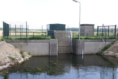 Waterpumping station at the Lierderholthuisweg in Wijhe to control water level and outlet in the Raaltewetering canal.  stock image