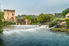 Waters and ancient buildings of Italian medieval village Royalty Free Stock Image