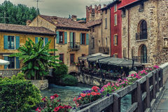 Waters and ancient buildings of Italian medieval village. Ancient buildings of a typical Italian medieval village: the river runs through the town, still passing Royalty Free Stock Image