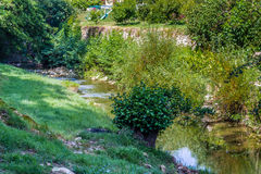 Waters bathing hill village Stock Photography