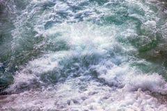 Seething, fluid, boiling, foaming, splashing water. The waters of chaos. Seething, fluid, boiling, foaming, splashing water of waterfall Royalty Free Stock Images