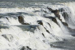 Waters and rocks of Gullfoss (Golden falls) waterfall, Iceland Stock Images