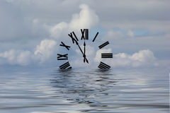 Waters of Time. Roman numeral clock floating in the water Stock Photos