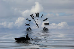 Waters of Time. Roman numeral clock floating in the water with a silhouette of a man rowing boat Stock Images