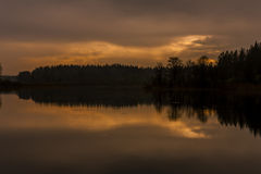 Waterscape nigh. Silent decline on lake after a thunder-storm Royalty Free Stock Image
