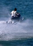 Waterscooter in Action. A waterscooter setting of into the ocean Royalty Free Stock Photography
