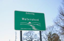 Watershed Entrance. A watershed is an area of land that drains all the streams and rainfall to a common outlet such as the outflow of a reservoir, mouth of a bay Stock Image