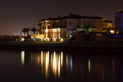 Waterside buildings at night Royalty Free Stock Photo