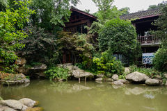 Waterside Chinese old building in summer green Royalty Free Stock Image