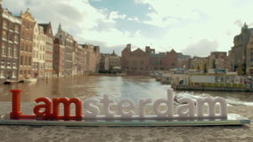 Waterside city view and Amsterdam slogan stock footage
