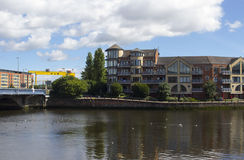 The waterside development of modern Belfast City with it`s high Rise buildings around the Queens bridge and the River Lagan at Don. Egall Quay. Modern apartment Royalty Free Stock Image