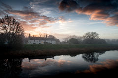 Waterside dwelling at dawn Stock Images