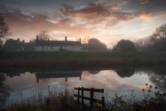 Waterside dwelling at dawn Royalty Free Stock Image