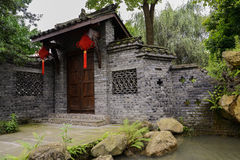 Waterside gate with Chinese knots in summer green Stock Images