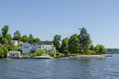 Waterside home Sweden Royalty Free Stock Image