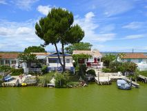 Waterside houses on French canal. Houses on the bank of the Canal du Rhone a Sete in Provence, France stock images