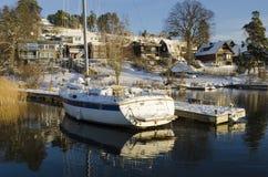 Waterside houses wintertime Sweden Royalty Free Stock Image
