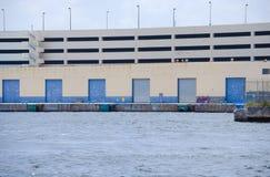 Waterside loading dock docks with breakwall Stock Photos
