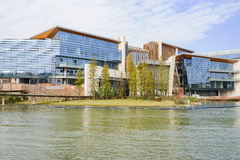 Waterside modern building under construction in cloudy winter af Stock Image
