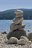 Waterside scenery with pebble pile Royalty Free Stock Photo