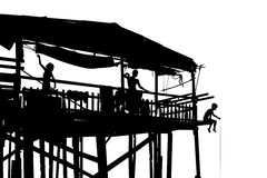 Waterside shack. Editable vector silhouette of a family in their shack on stilts with people as separate objects Stock Photo