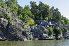 Waterside summerhouse on a cliff Stock Image