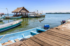 Waterside view, Livingston, Guatemala. Livingston, Guatemala - August 31, 2016: Boats moored by dock in Caribbean town of Livingston Royalty Free Stock Photography