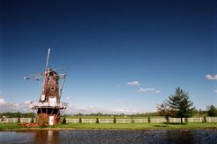 Waterside Windmill Royalty Free Stock Photos