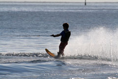 Waterski wake. Boy carving a Waterski wake on the water Stock Photos